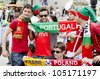 LVIV, UKRAINE - JUNE 13:  Portugal football fans in the center of the Lvov city, before the match Denmark- Portugal on June 13, 2012 in Lviv, Ukraine. - stock photo