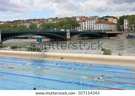 LYON, FRANCE - JUNE 16, 2016:  City views of the city. Lyon Architecture. Open-air swimming pool on the Quai Claude Bernard by the river Rone river. Swimming Pool in Lyon France
