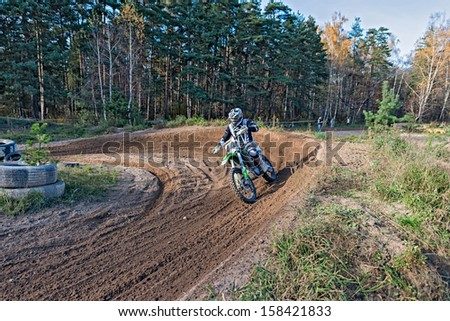 LYTKARINO, MOSCOW REGION, RUSSIA - OCTOBER 12: Riders in action during competition motocross in Lytkarino on October 12, 2013.