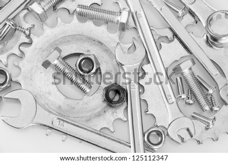 Machine gear, metal cogwheels, nuts and bolts background, close-up