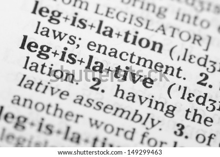 Macro image of dictionary definition of word legislative - stock photo