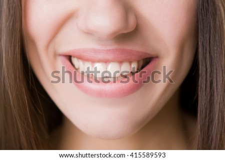 Macro of lips and white teeth. Smiling.