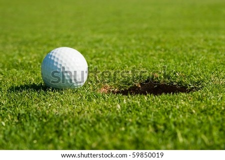 macro photo from golf ball and hole