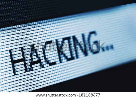 Macro photo of the word Hacking on LCD