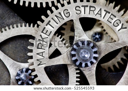Macro photo of tooth wheel mechanism with MARKETING STRATEGY concept letters