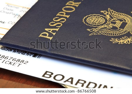 Macro shot of passport and boarding pass