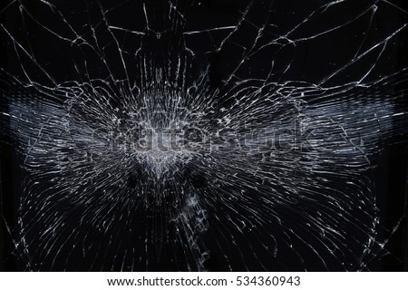 macro texture background broken glass with radial cracks on a black background