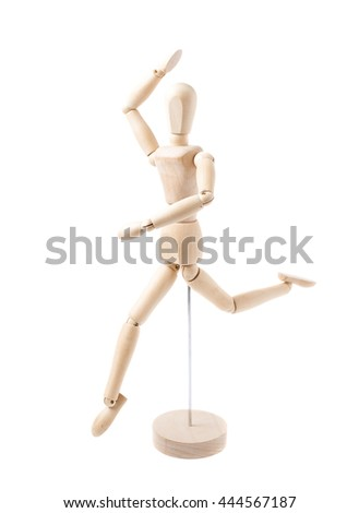 Made of wood human doll puppet statuette while dancing, composition isolated over the white background