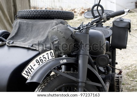 "MADRID - MARCH 5: Detail of a German motorcycle. Re-enactment of World War II by the ""Historic Re-enactment Group of Legan�©s"" on March 5, 2012 in Madrid."