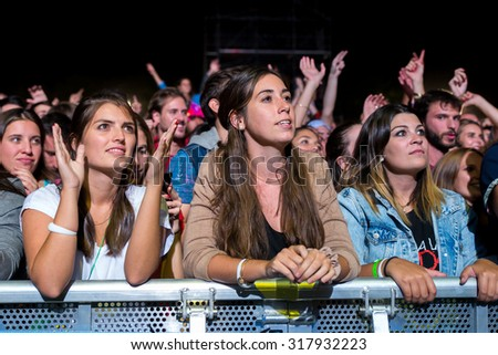 MADRID - SEP 12: Crowd in a concert at Dcode Festival on September 12, 2015 in Madrid, Spain.