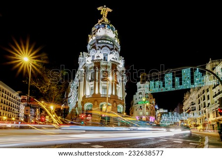 MADRID, SPAIN - DECEMBER 20: Madrid at Christmas. Rays of traffic lights on Gran via street, main shopping street in Madrid at night. in December 20, 2013 in Madrid, Spain.