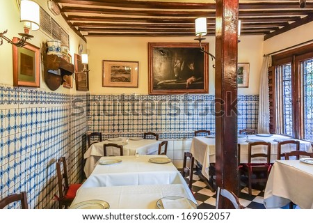 MADRID, SPAIN - NOVEMBER 19, 2013: Interior of Sobrino de Botin (Calle de los Cuchilleros, 17) - oldest restaurant in world (1725), was founded by a Jean Botin. Artist Goya worked there as a waiter.