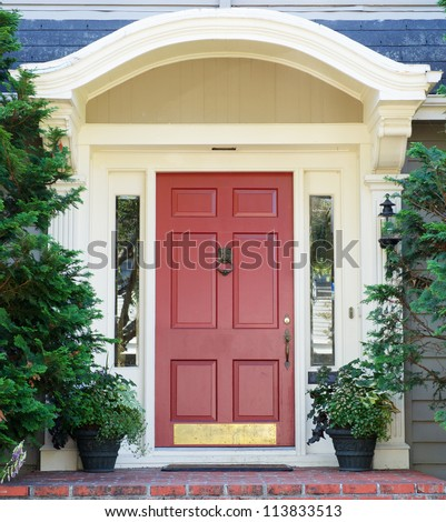 Magenta home door with arched top with two windows
