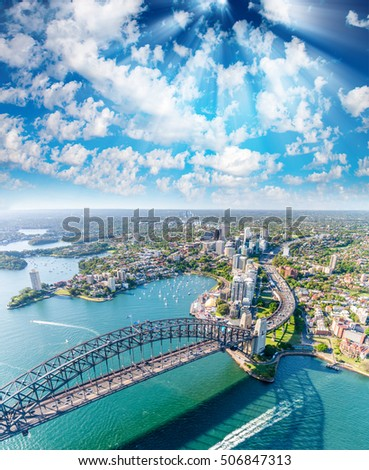 Magnificence of Sydney Harbor at sunset, aerial view from helicopter.