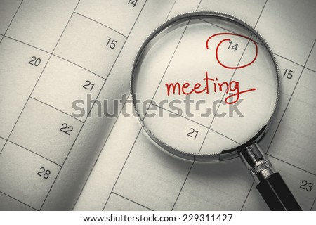 magnifying glass focus meeting date on dairy
