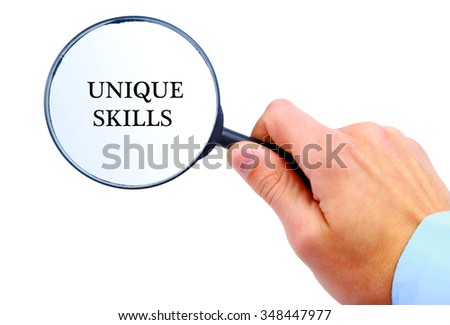 "Magnifying glass in hand isolated on white background searching ""Unique Skills"""