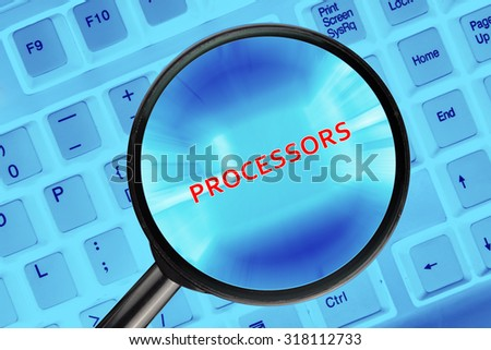"Magnifying glass on computer keyboard with ""Processors"" word."
