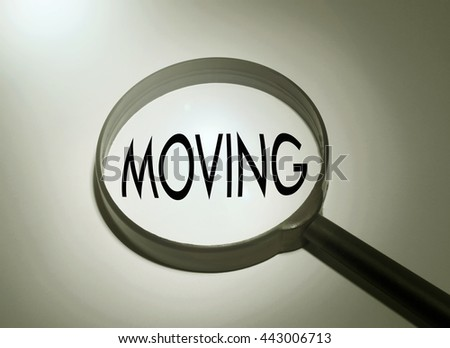 Magnifying glass with the word moving. Searching moving