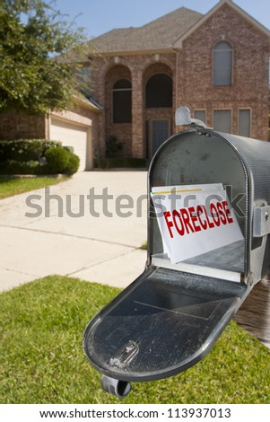 Mailbox filled with monthly bills and notices