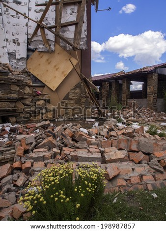 "MAKAROVO, LUHANSK REGIPN, UKRAINE - June 13, 2014: Restaurant ""Caravan"", which was destroyed by mines. In Makarovo village (about 20 km east of Lugansk) was shelled checkpoint pro-Russian insurgents."