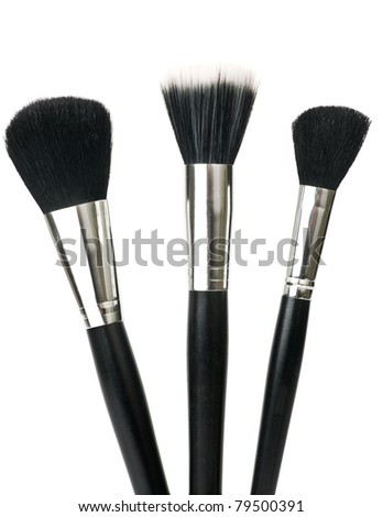 Make up brushes for powder isolated over white.