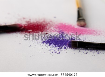 makeup brush and powder, focus on purple brush