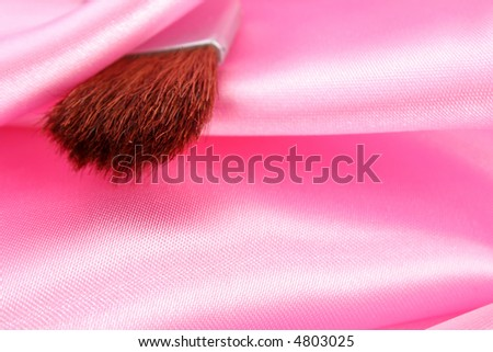 Makeup brush on pink satin 1