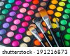Makeup brushes and make-up eye shadows - stock photo