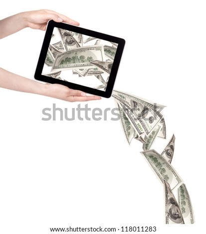 making money with computer concept - Money pouring out from a Tablet pc