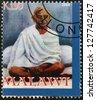 MALAWI - CIRCA 2004: A stamp printed in Malawi shows Mohandas Karamchand Gandhi, circa 2004 - stock photo