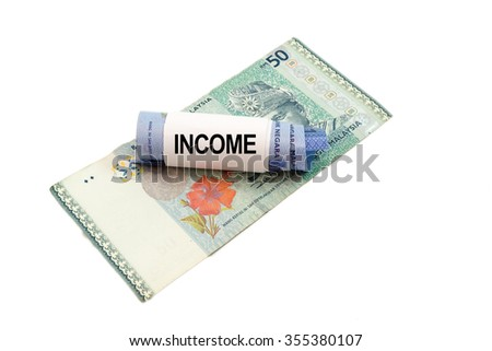 Malaysia banknote with word INCOME isolated on white background