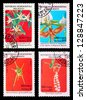 MALAYSIA - CIRCA 1985: A set of postage stamps printed in MALAYSIA shows flowers, series, circa 1985 - stock photo