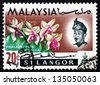 MALAYSIA - CIRCA 1965: a stamp printed in Malaysia shows Phalaenopsis Violacea, Orchid Flower, circa 1965 - stock photo