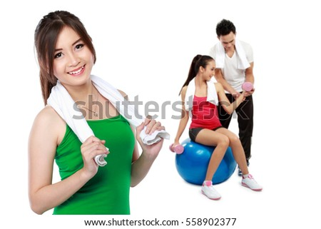 male and female friends doing exercise together at the gym