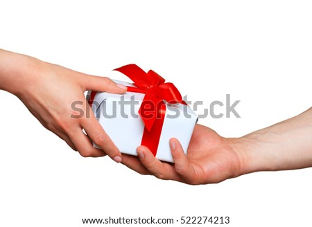 Male and female hands with white gift box with bow over white