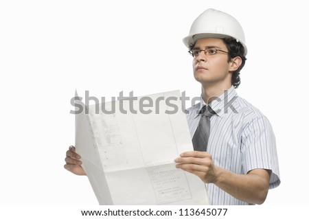 Male architect holding a blueprint