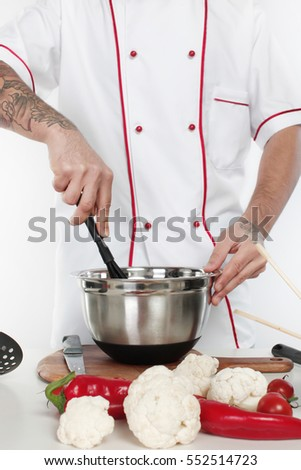 male chef dressed in white uniform cooking food,isolated on white