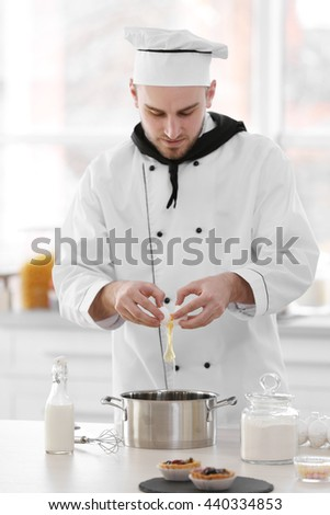 Male chef working at kitchen