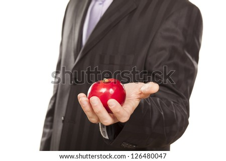 male hand holding a red apple on white background