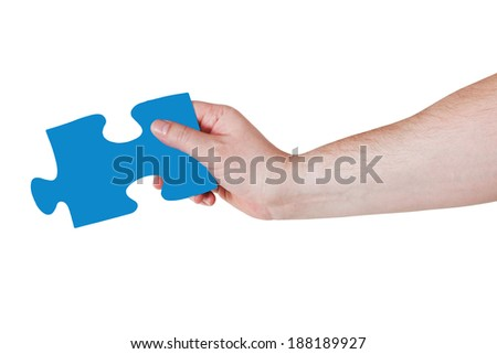 male hand with blue puzzle piece isolated on white background