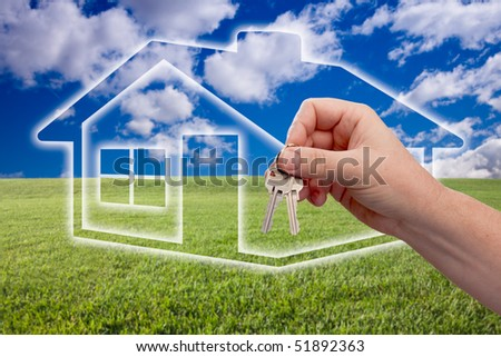 Male Handing Over Keys on Ghosted Home Icon, Grass Field, Clouds and Sky.