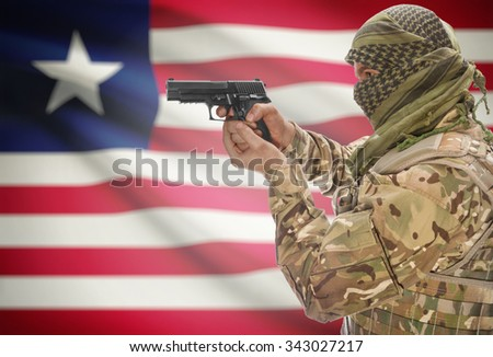 Male in muslim keffiyeh with gun in hand and national flag on background series - Liberia