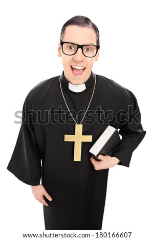 Male priest holding a holy bible and looking at the camera isolated on white background
