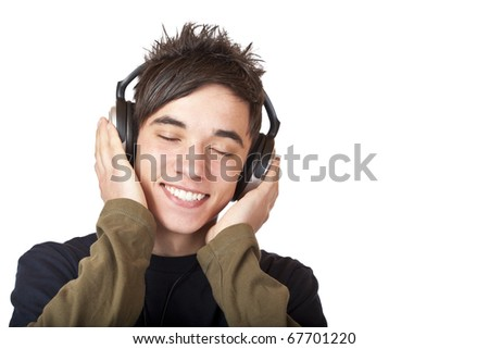 Male Teenager listening to music via headphone. Isolated on white background.