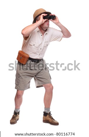 Male traveler with his binocular. Studio shot isolated on white background