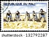 "MALI CIRCA 1966: stamp printed in Mali, shows Group Fishing with Large Net, without inscription, from the series ""River Fishing"", circa 1966 - stock photo"