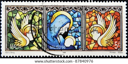 MALTA - CIRCA 1996: A stamp printed in Malta shows drawing of a window with the virgin and the child and the angels, circa 1996