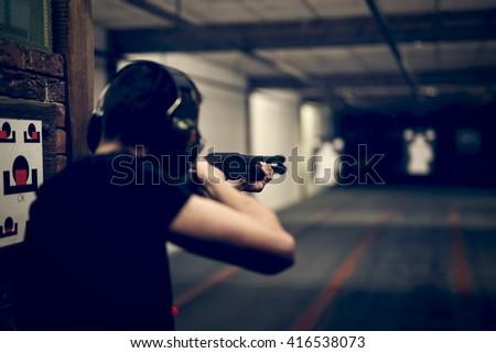 Man Aiming Pistol Target Indoor Firing Stock Photo ...
