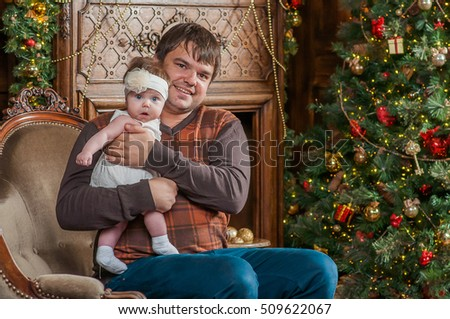 Man and cute baby are ready to celebrate new year