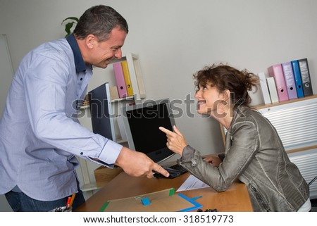 Man and woman at work in modern office
